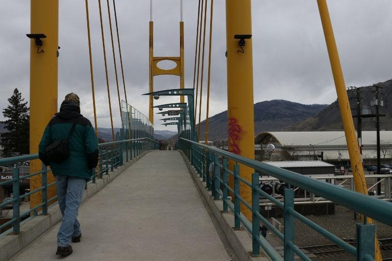 Bryan-Hunt-1-Walking-along-on-bridge
