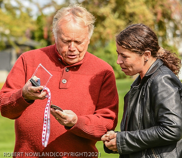 Brian Mitchell, KPAC's Inter-club liaison presents Crystal Fennel with CAPA Medal in hounor of her exceptional service to KPAC and the world of Photography Sept. 18, 2021